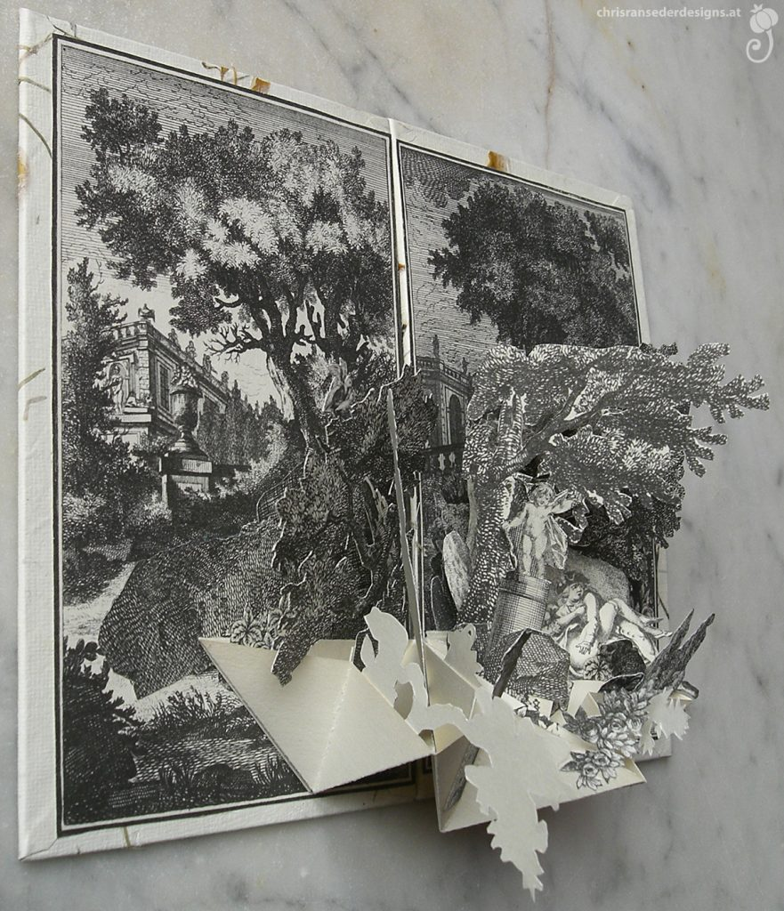 Pop-up book showing a garden and a couple. | Pop-up-Buch,  das eine Gartenszene mit einem Pärchen zeigt.