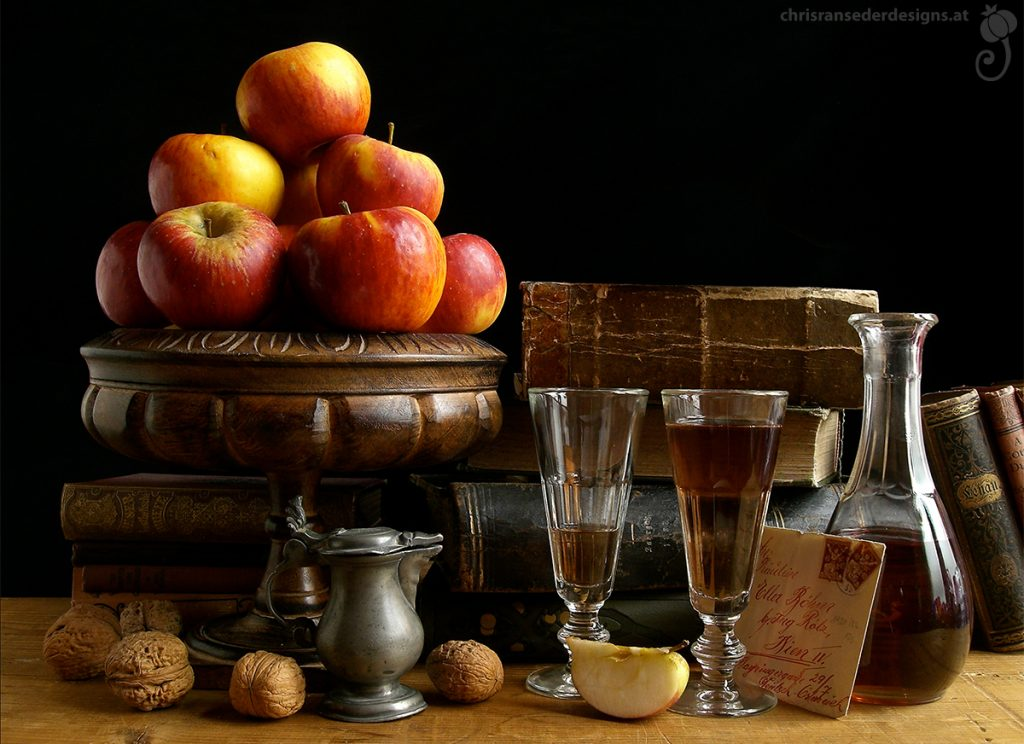 Still life comprising old books, a bowl with apples and glassware. | Stillleben mit alten Büchern, einer Schale mit Äpfeln und Glasgefäßen.